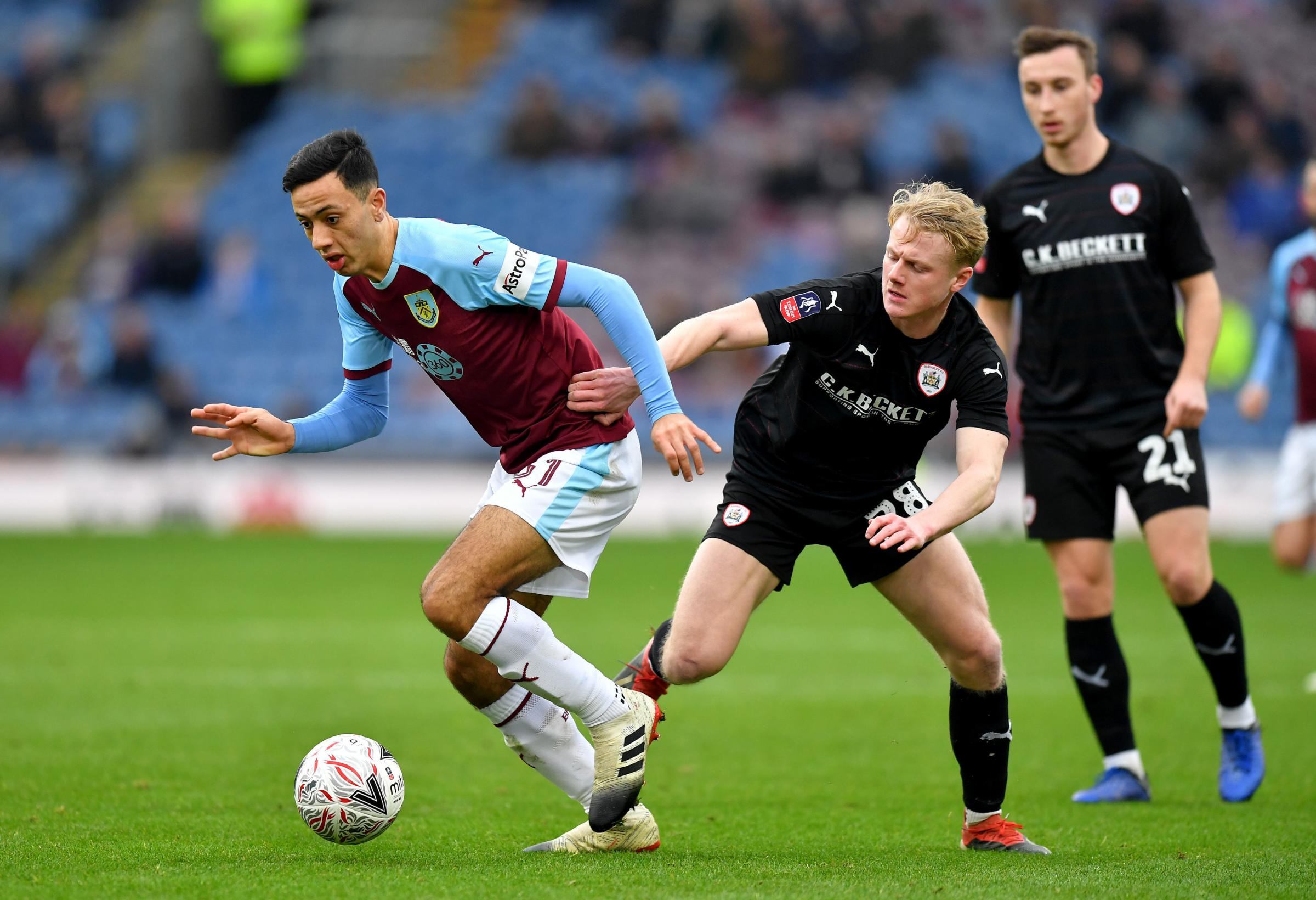 Burnley's Dwight McNeil (left) and Barnsley's Ben Williams (right) battle for the ball during the Emirates FA Cup, third round match at Turf Moor, Burnley. PRESS ASSOCIATION Photo. Picture date: Saturday January 5, 2019. See PA story SOCCER Burnle