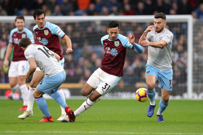 Burnley's Dwight McNeil (centre) and West Ham United's Robert Snodgrass (right) battle for the ball during the Premier League match at Turf Moor, Burnley. PRESS ASSOCIATION Photo. Picture date: Sunday December 30, 2018. See PA story SOCCER Burnley