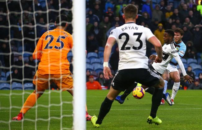 Fulham's Joe Bryan (second left) scores an own goal, Burnley's first of the game, during the Premier League match at Turf Moor, Burnley. PRESS ASSOCIATION Photo. Picture date: Saturday January 12, 2019. See PA story SOCCER Burnley. Photo credit sh