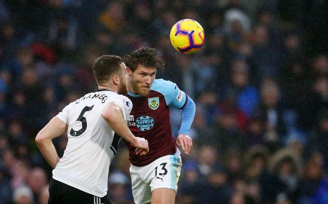 Fulham's Calum Chambers (left) and Burnley's Jeff Hendrick battle for the ball during the Premier League match at Turf Moor, Burnley. PRESS ASSOCIATION Photo. Picture date: Saturday January 12, 2019. See PA story SOCCER Burnley. Photo credit shoul