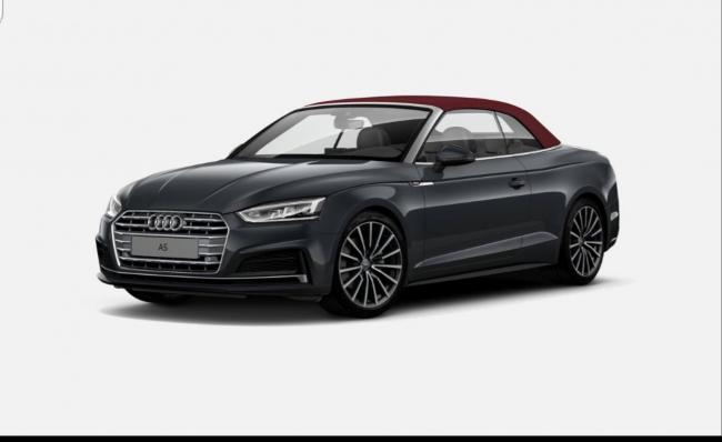 A Manhatten grey Audi S-Line with a burgandy red roof was stolen after a burglary from an address in Whalley.