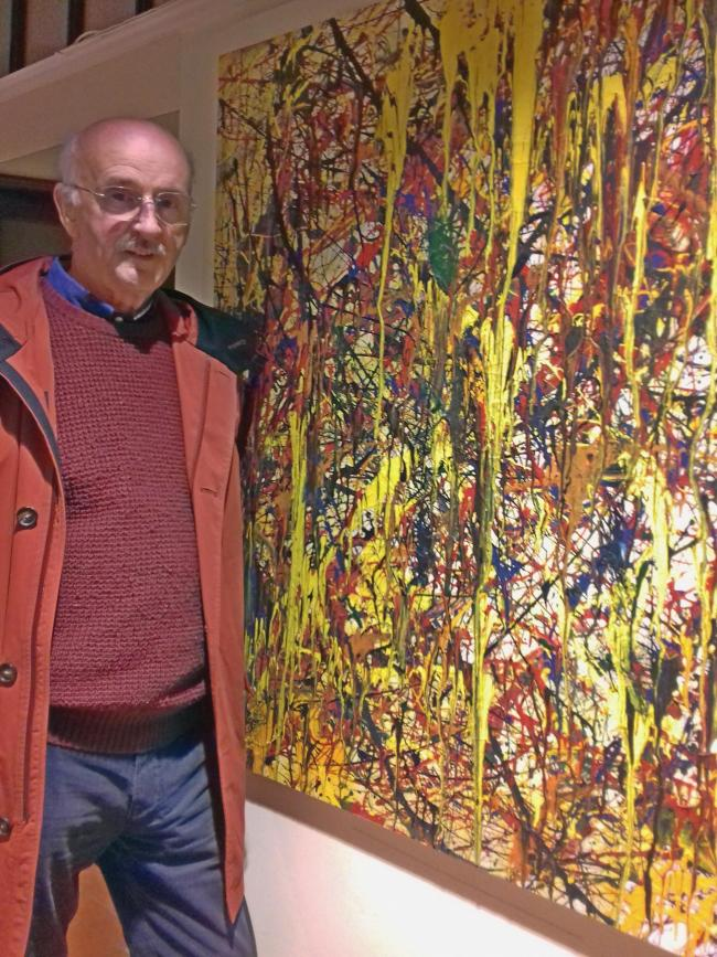 Nigel Airey with his painting with is being auctioned for charity