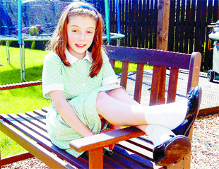 BACK HOME: Hollie relaxes in the garden after school