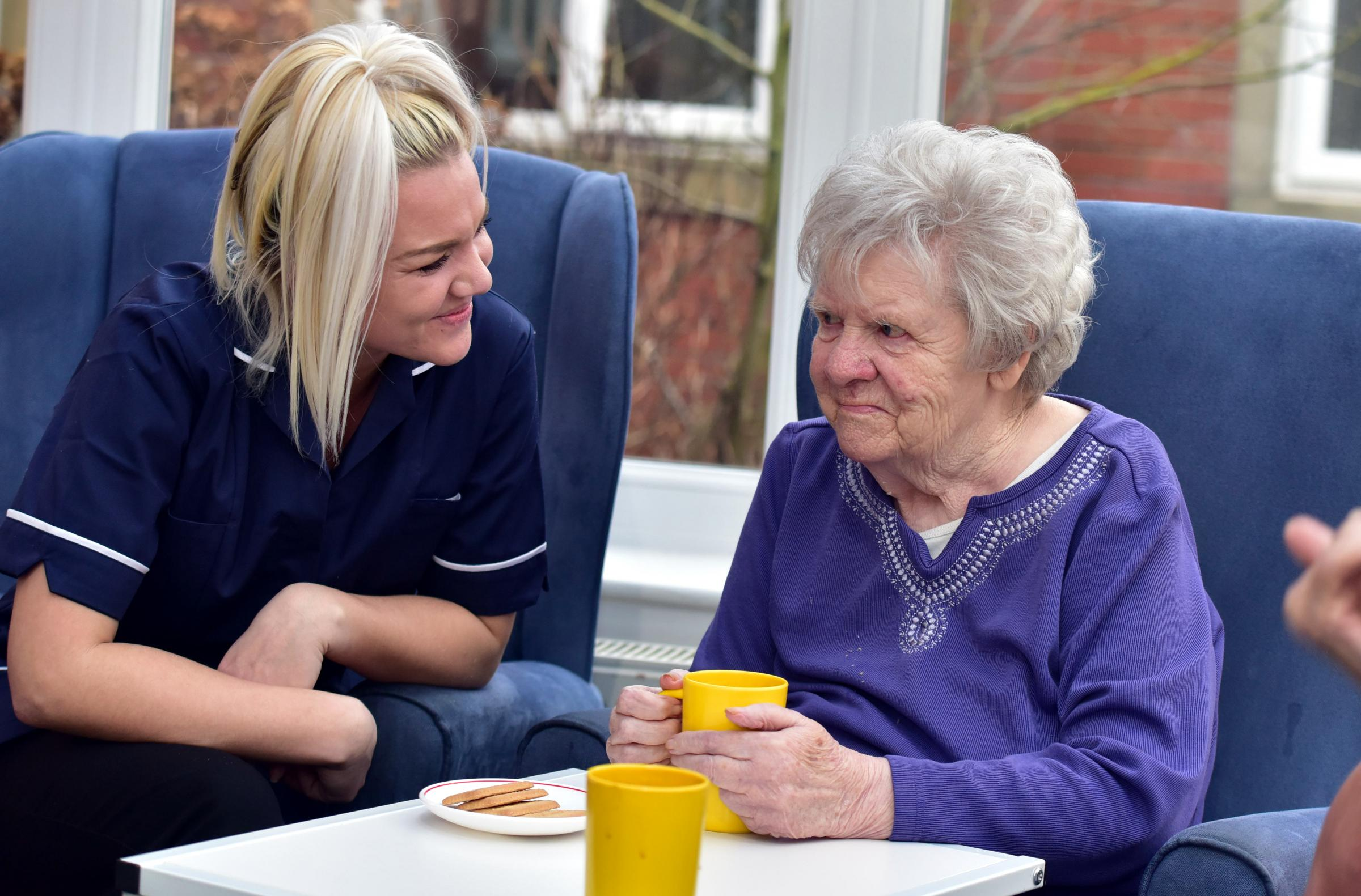 Senior carer Jennifer Holmes with resident Margaret Hirst at Abbey Grange Residential Care Home, Burnley