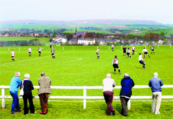 EYE ON THE BALL: Spectators enjoy the game between the Old Boltonians AFC and Rossendale AFC at Chapeltown