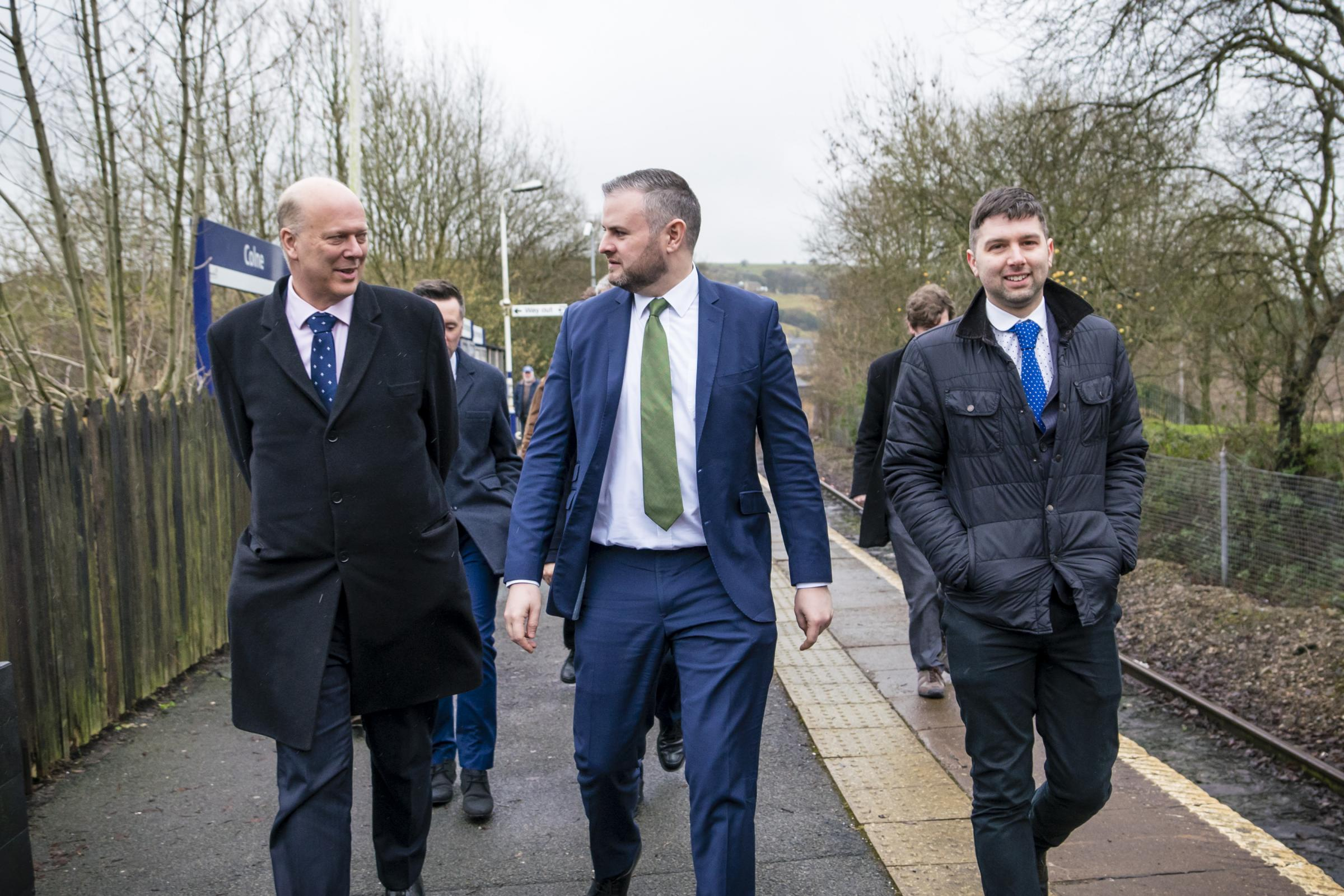 Chris Grayling (left) with Pendle MP Andrew Stephenson (centre) and Colne Town Councillor Ash Sutcliffe  on Colne railway station