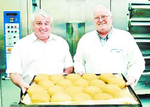 ON A ROLL: Richard McDonald and Alec Fleck at the Bread Roll Bakery