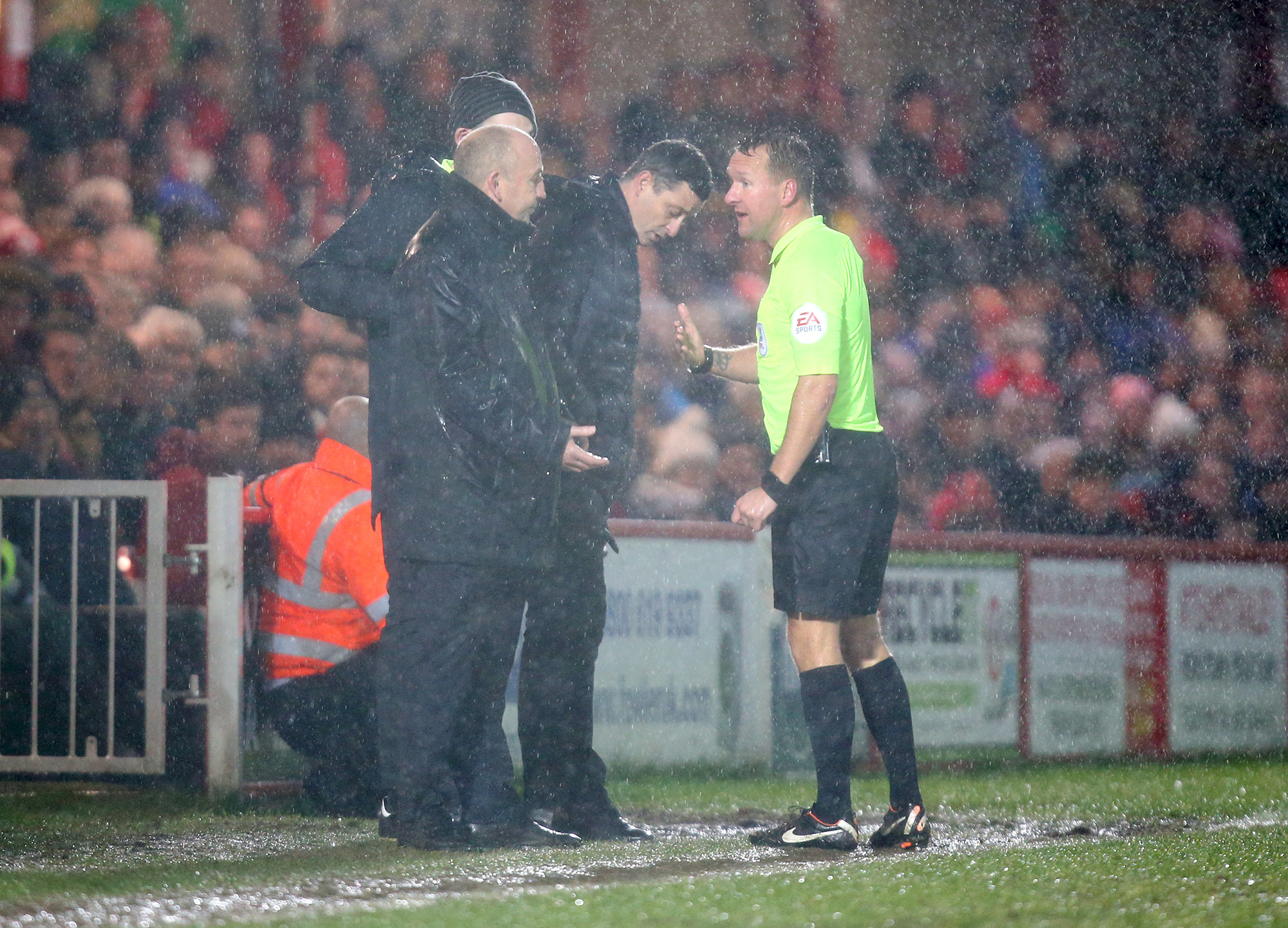match referee oliver langford consults with managers and 4th official before allowing a few more minutes play .during the EFL  skybet league 1 Football match between Accrington Stanley and Sunderland  at the WHAM Stadium, Accrington   on the 8th december