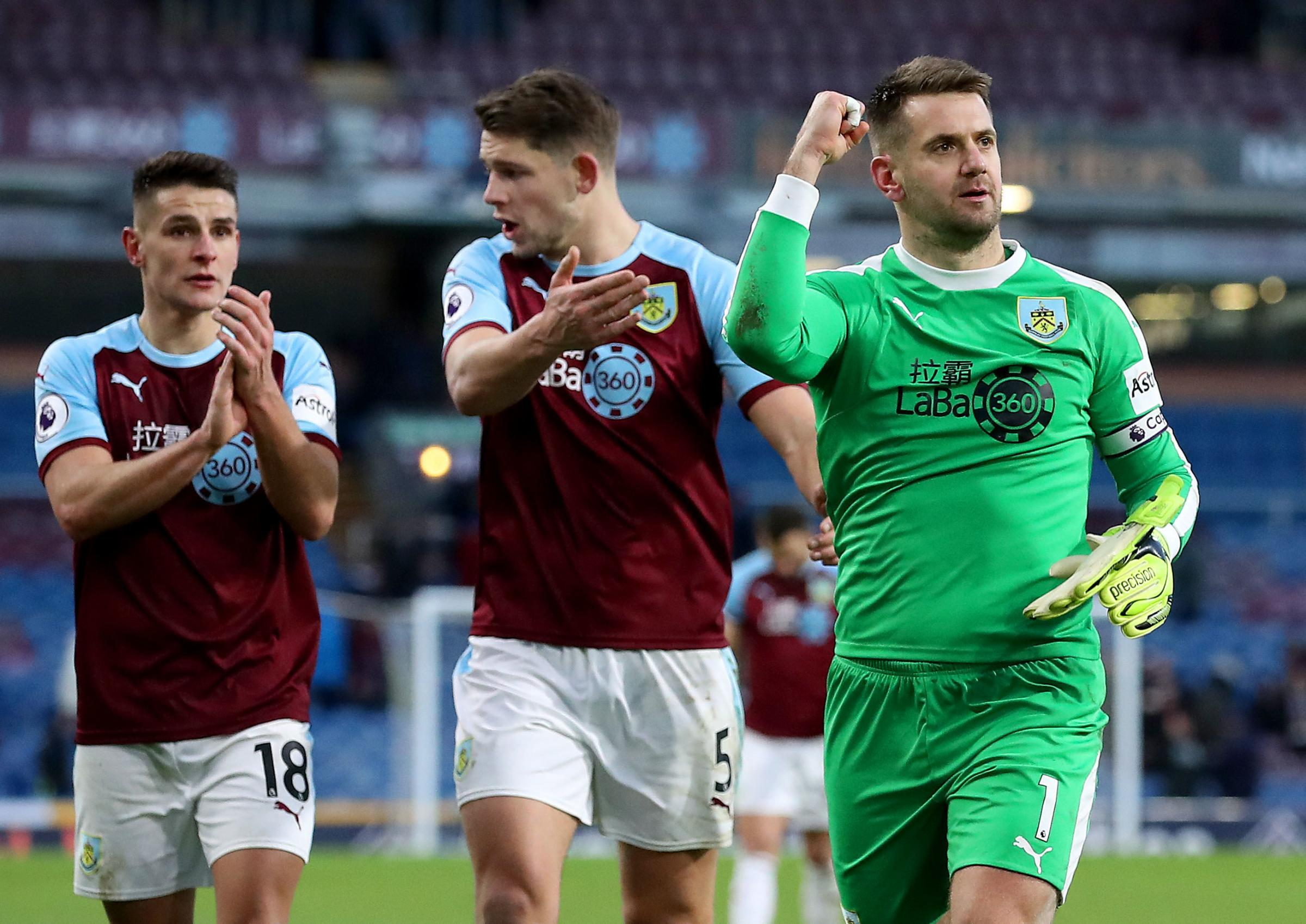 Burnley's Ashley Westwood (left) and James Tarkowski (centre) as Tom Heaton (right) celebrates the point after the Premier League match at Turf Moor, Burnley. PRESS ASSOCIATION Photo. Picture date: Saturday February 2, 2019. See PA story SOCCER Burnl