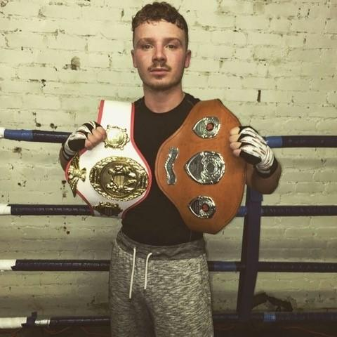 Earby boxer Josh Holmes with his two Yorkshire title belts.