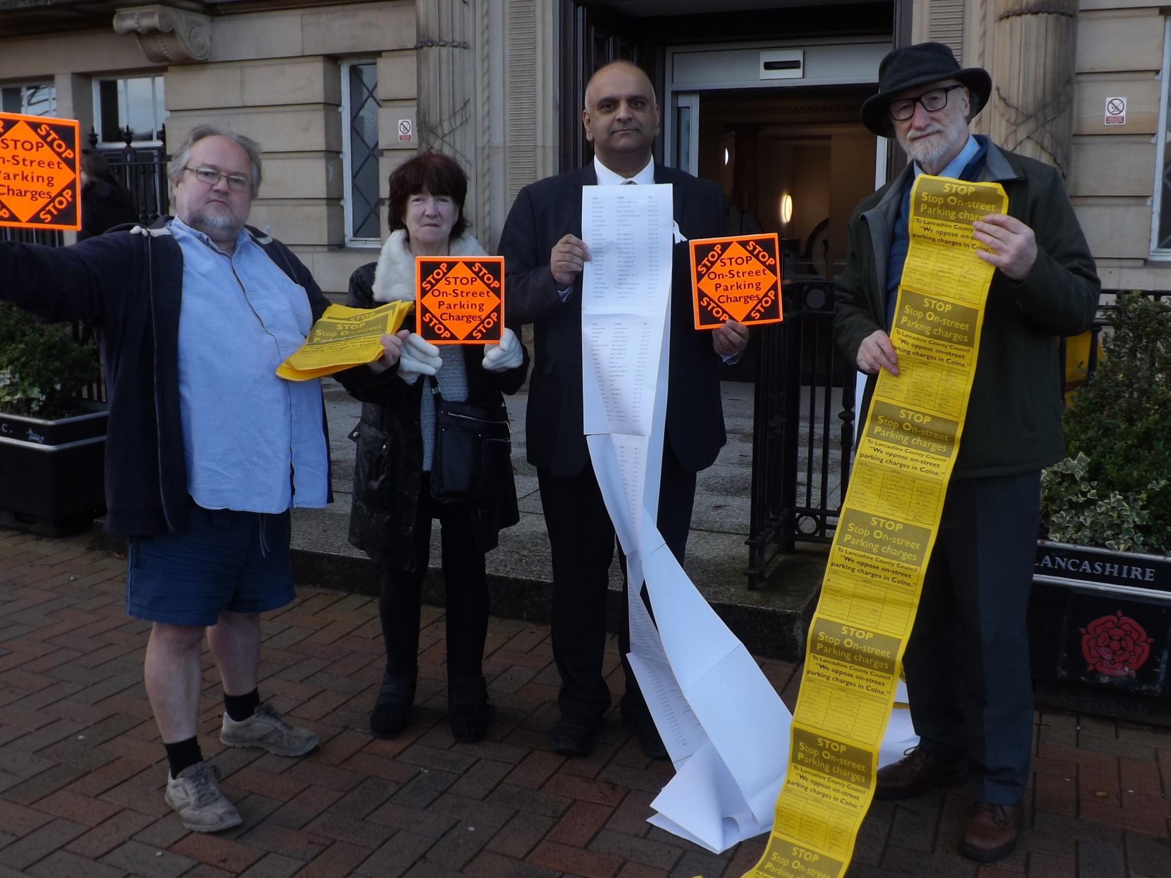 Protestors against new car parking charges in Colne and Nelson outside County Hall, Preston. From the left:County Liberal Democrat Group Leader David Whipp, Pendle Borough Councillor Dorothy Lord, County Labour Group Leader Azhar Ali, and Pendle Councillo