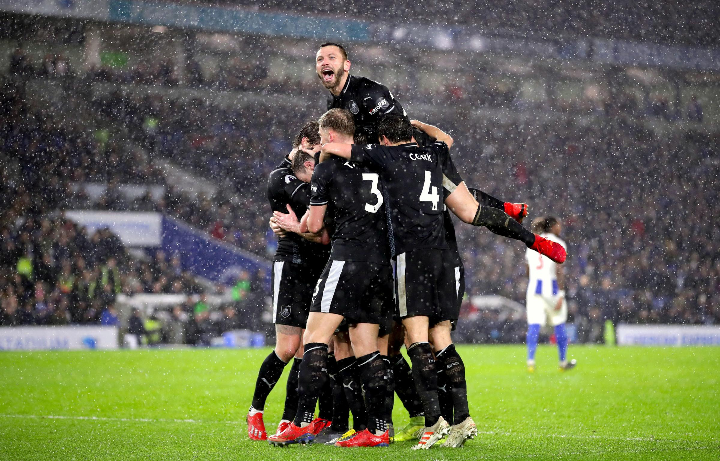 Burnley's Ashley Barnes celebrates scoring his side's third goal of the game from the penalty spot with team mates during the Premier League match at the AMEX Stadium, Brighton. PRESS ASSOCIATION Photo. Picture date: Saturday February 9, 2019. Se