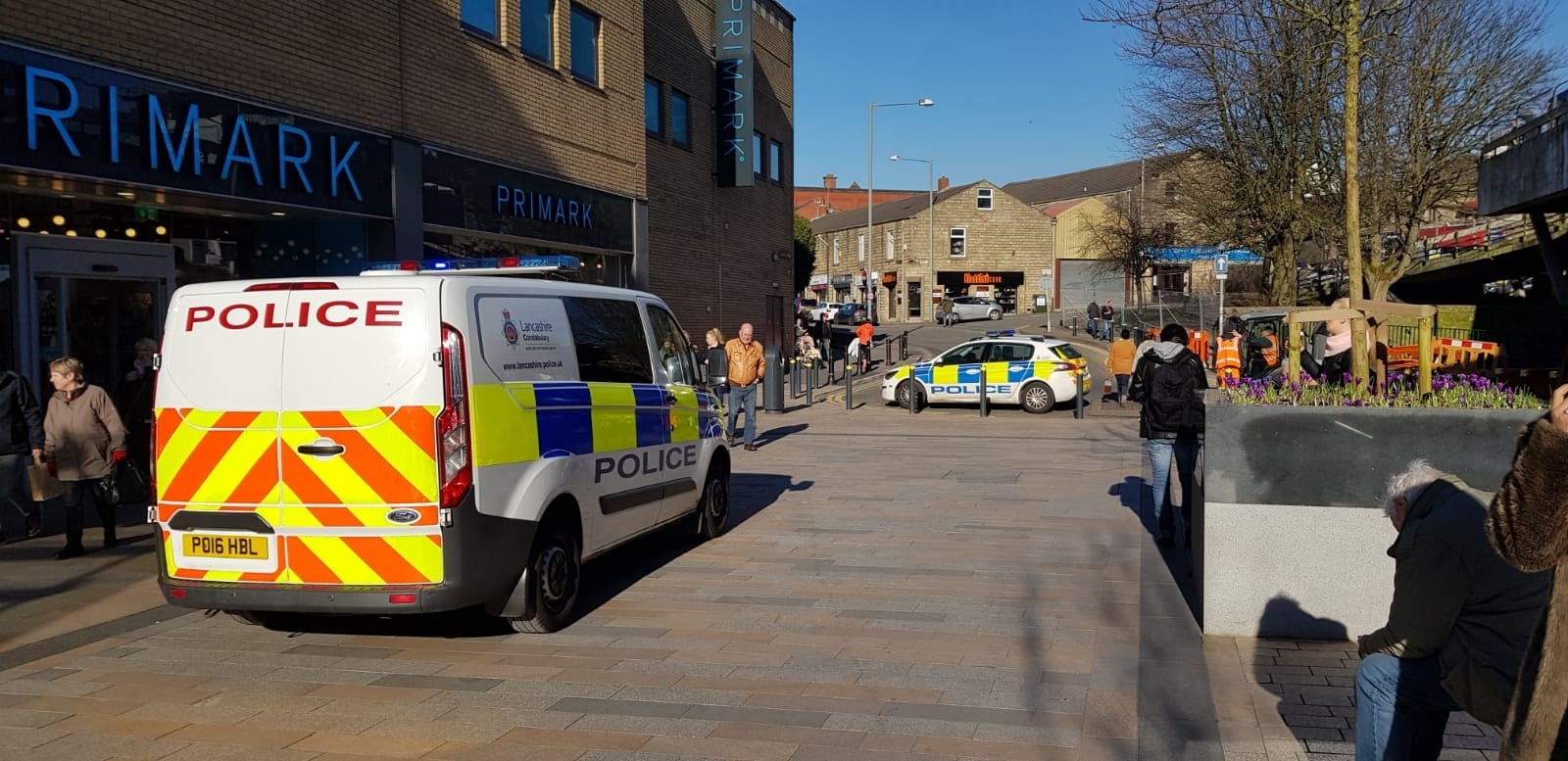 A police van and a car outside Primark in Burnley