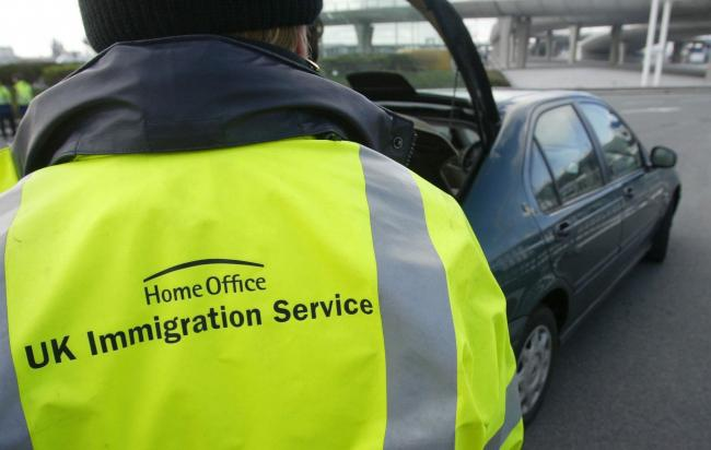U.K. Immigration Officers as they stop check vehicles moving through passport control bound for England