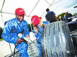WHEELY GOOD: Masimba gets to grips with rapid wheel changing