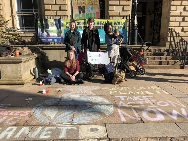 Protestors outside Blackburn Town Hall who are concerned about climate change