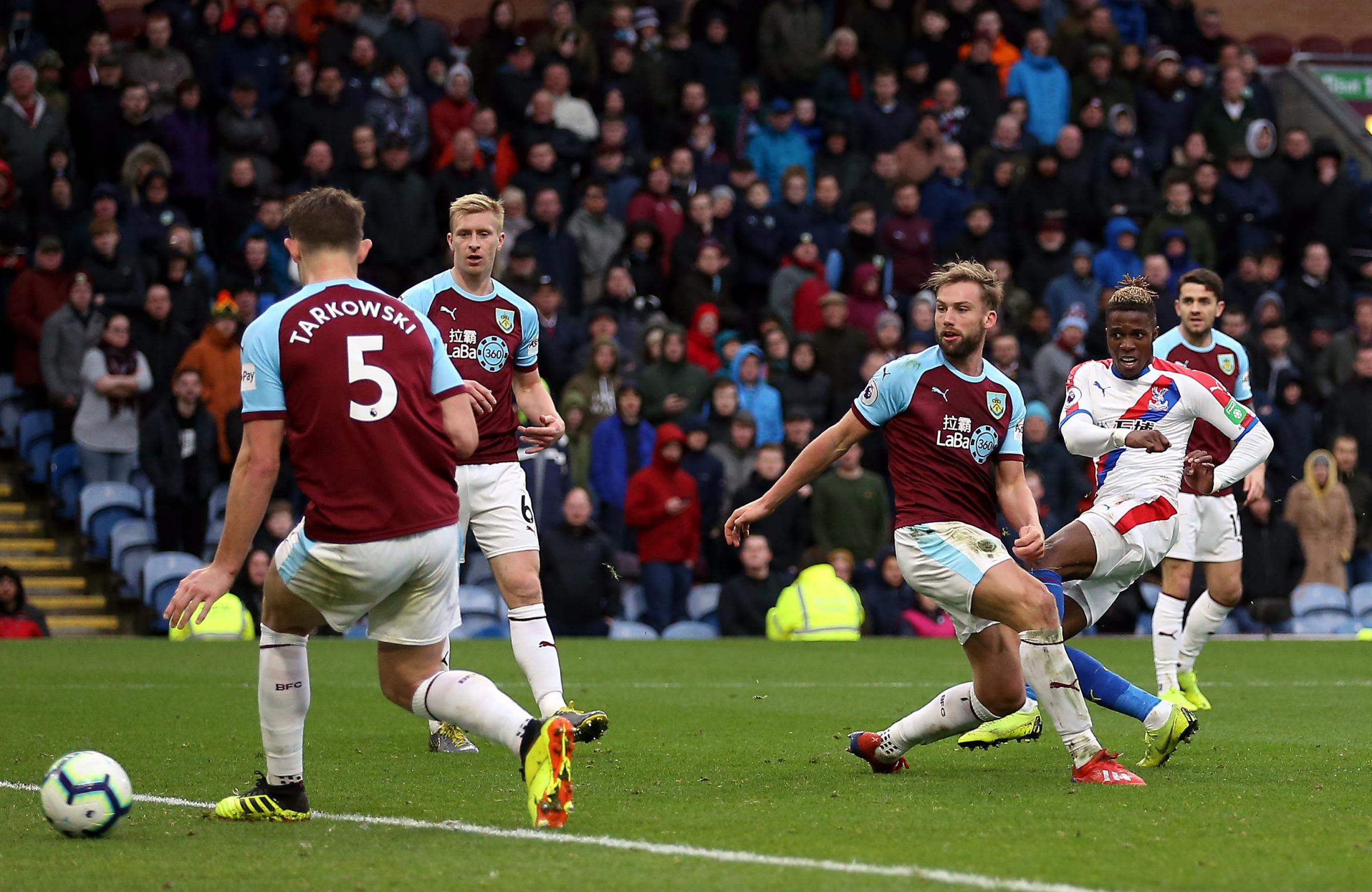 Crystal Palace's Wilfried Zaha scores his side's third goal of the game during the Premier League match at Turf Moor, Burnley. PRESS ASSOCIATION Photo. Picture date: Saturday March 2, 2019. See PA story SOCCER Burnley. Photo credit should read: N
