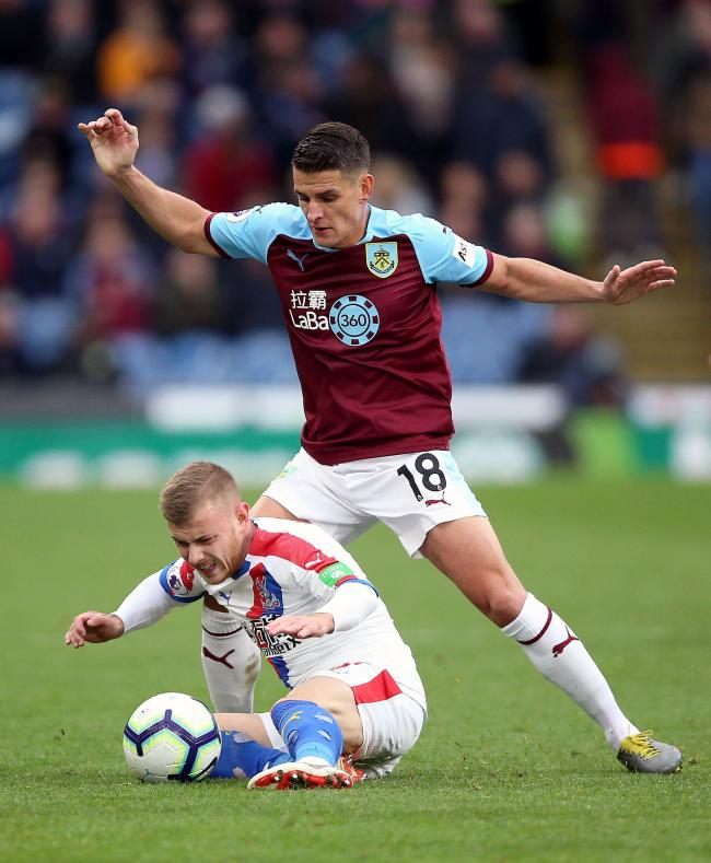 Burnley's Ashley Westwood (right) and Crystal Palace's Max Meyer battle for the ball during the Premier League match at Turf Moor, Burnley. PRESS ASSOCIATION Photo. Picture date: Saturday March 2, 2019. See PA story SOCCER Burnley. Photo credit s