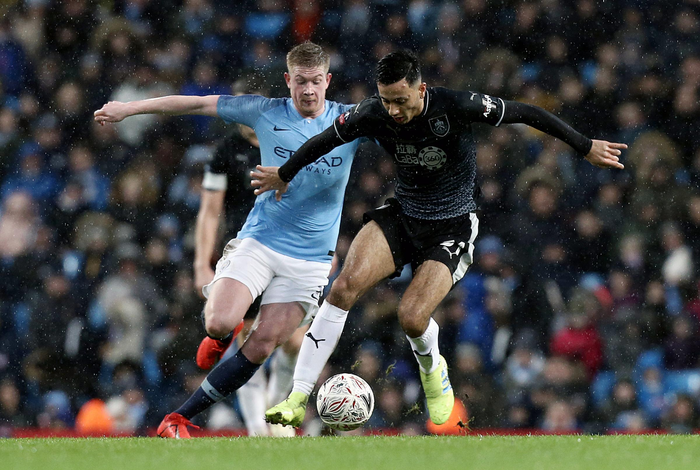 Burnley's Dwight McNeil under pressure from Manchester City's Kevin De Bruyne
