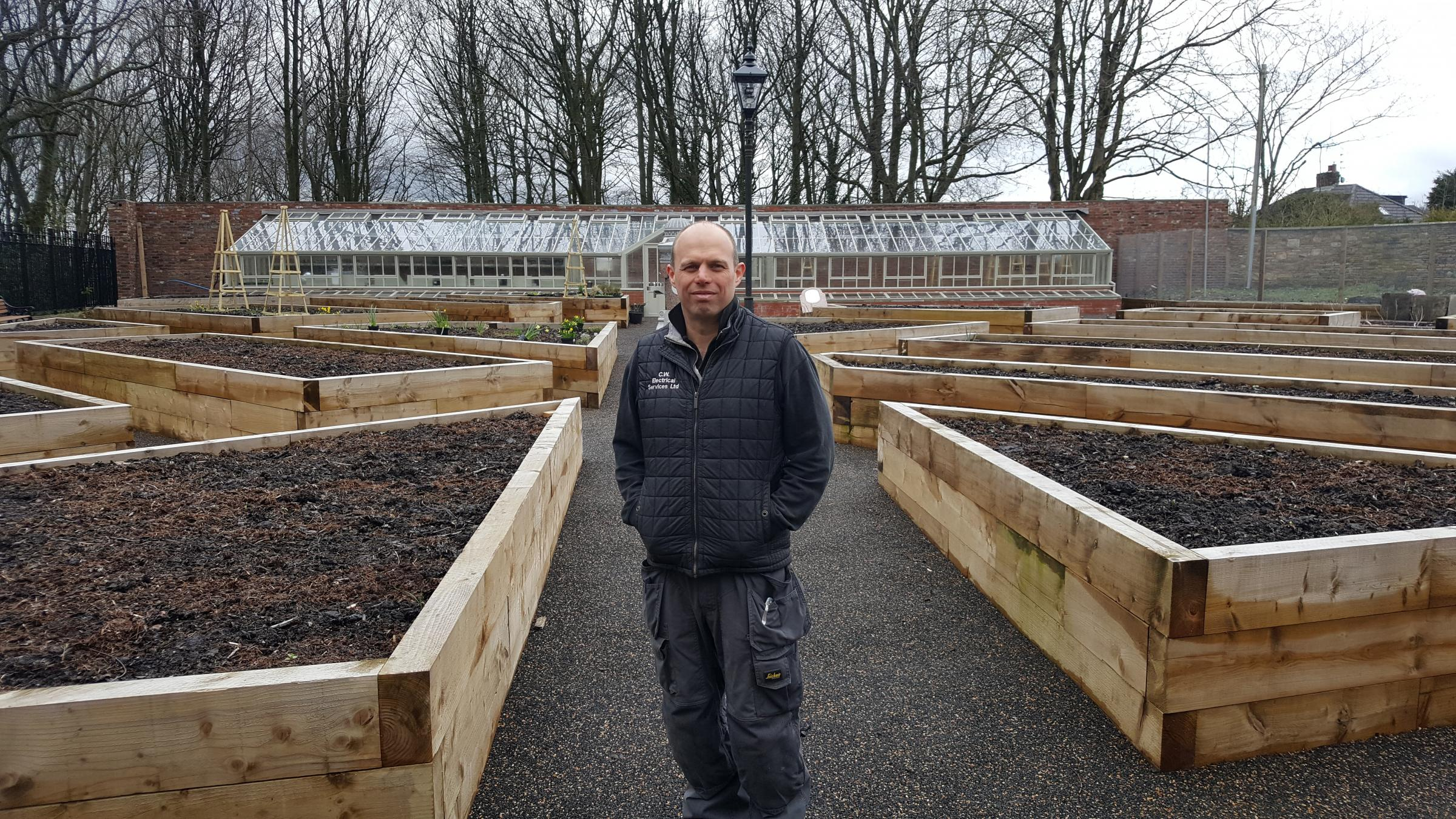 Cllr Paul Cox in the walled garden at Rhyddings Park