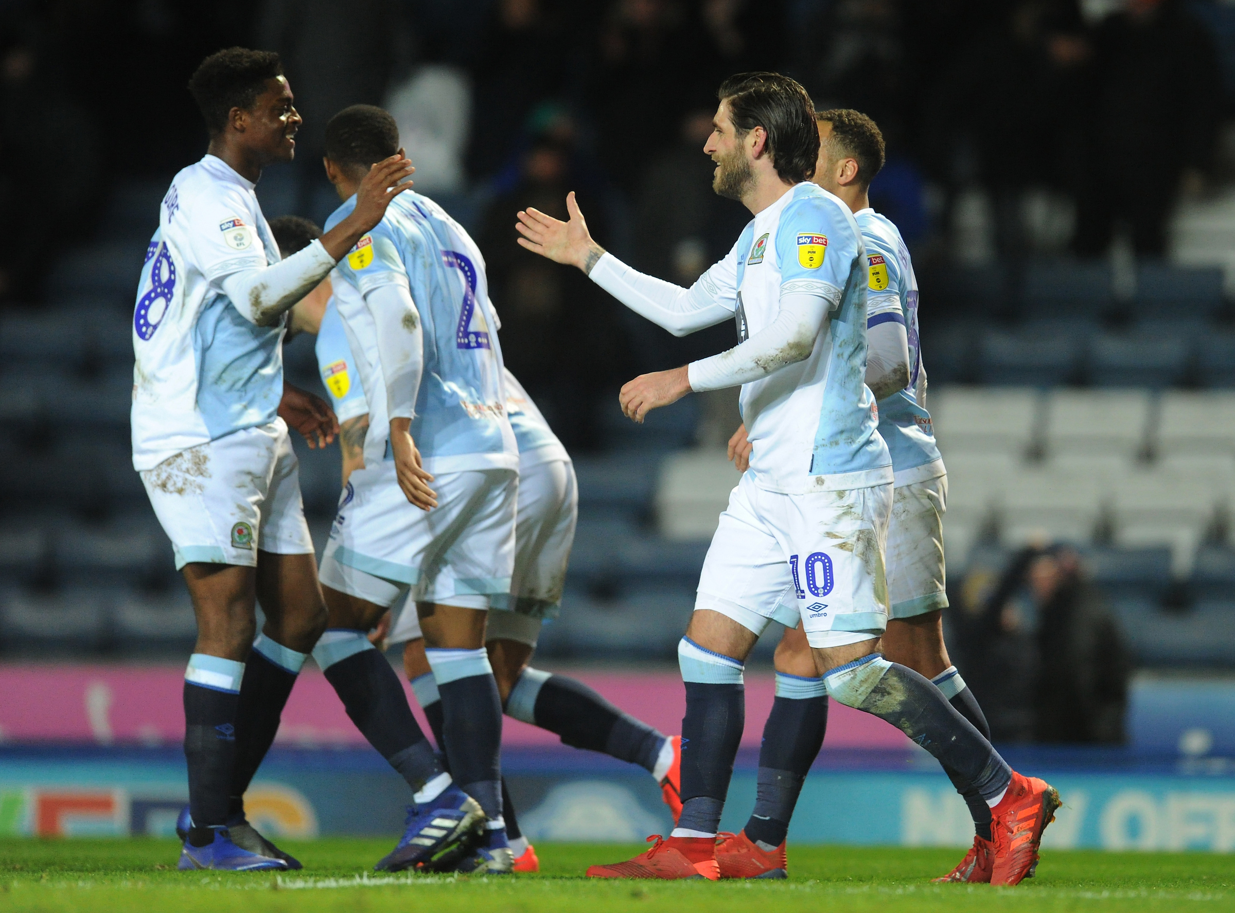 Danny Graham and Tyler Magloire celebrate during Rovers' win over Wigan Athletic