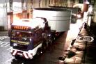 A POLICE escort was used on Monday evening to help two lorries with abnormally large loads manoeuvre their way through the streets of Darwen. The two trucks, each carrying two large cylinders, were making their way from Darwen to Derby, a council spokesma
