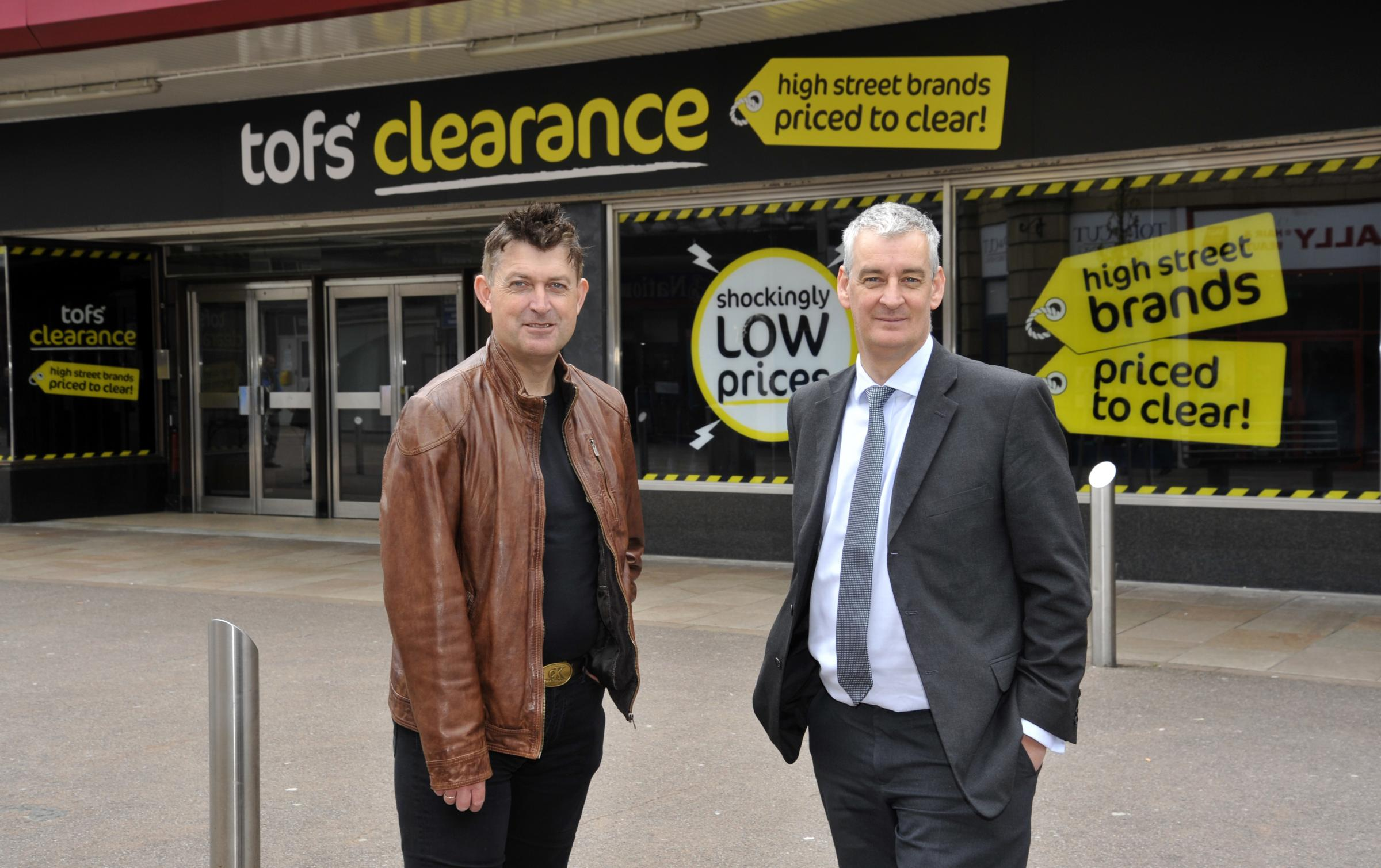 NEW SHOP: Coun Miles Parkinson, Leader of the Council and MP Graham Jones outside TOFS on Broadway in Accrington.
