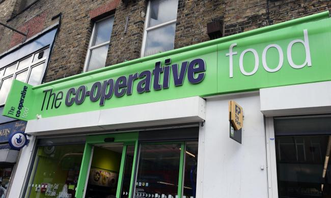 File photo File photo dated 22/04/14 of a branch of  The co-operative food store in London, as the Co-operative Group has swung into profit for the first half of the year but warned annual results would see a drop in earnings due to investment under a swe