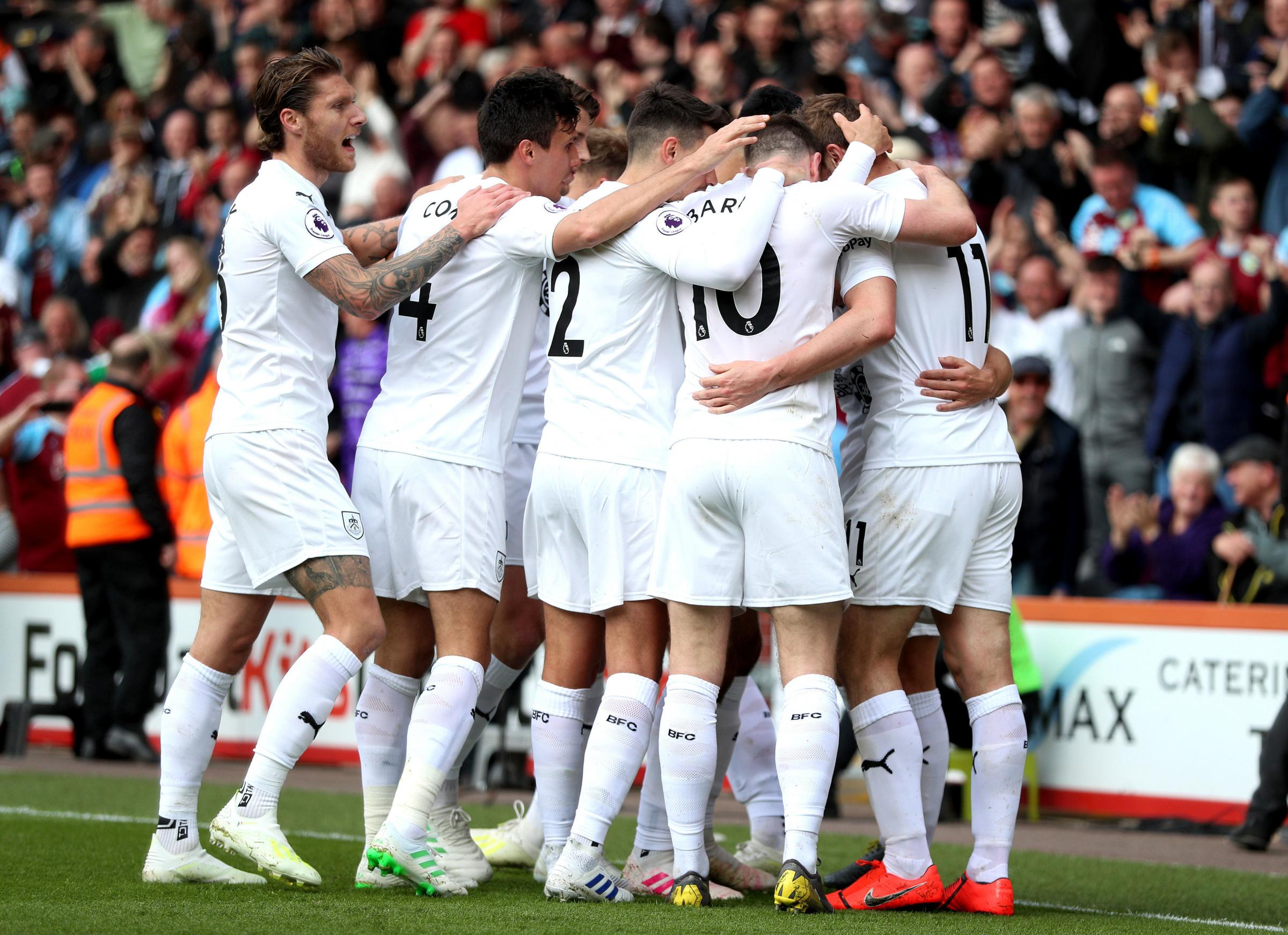 Burnley celebrate Chris Wood's equalising goal in their 3-1 win at Bournemouth