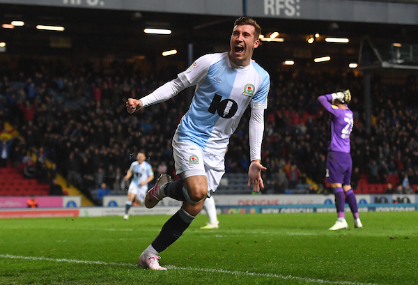 Joe Rothwell celebrates putting Rovers ahead against Derby
