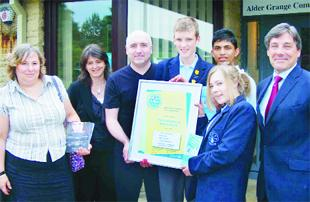 Unicef's Eddie Burke presents pupils Robert Pratt, 15, Zafor Miah, 14, and Alice Payne, 15, with the award, watched by Odette Freeman, trustee of the Sophie Lancaster Foundation, deputy head Jo Griffiths and headteacher Iain Hulland