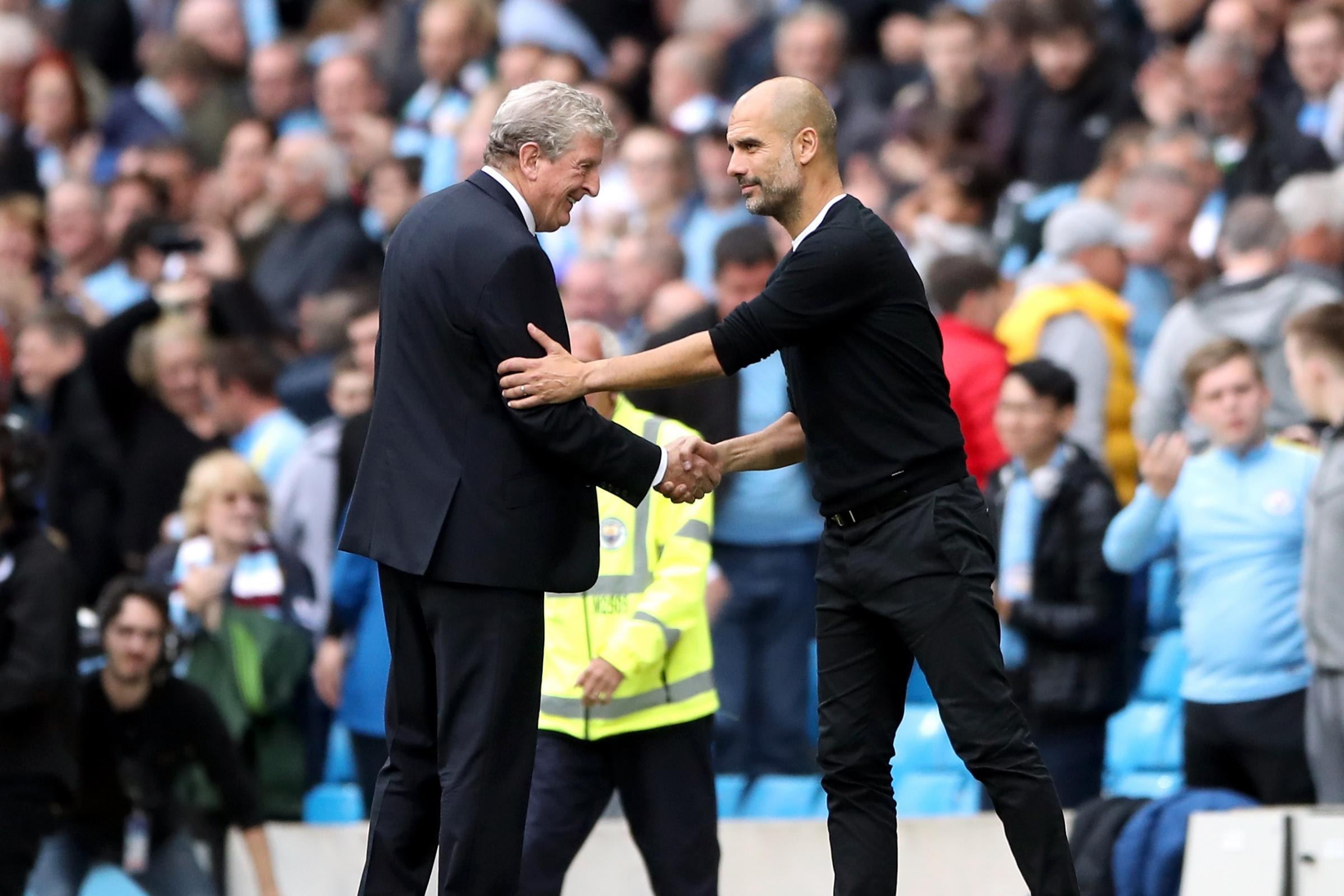 Pep Guardiola (right) does not intend to manage for as long as Roy Hodgson (left)