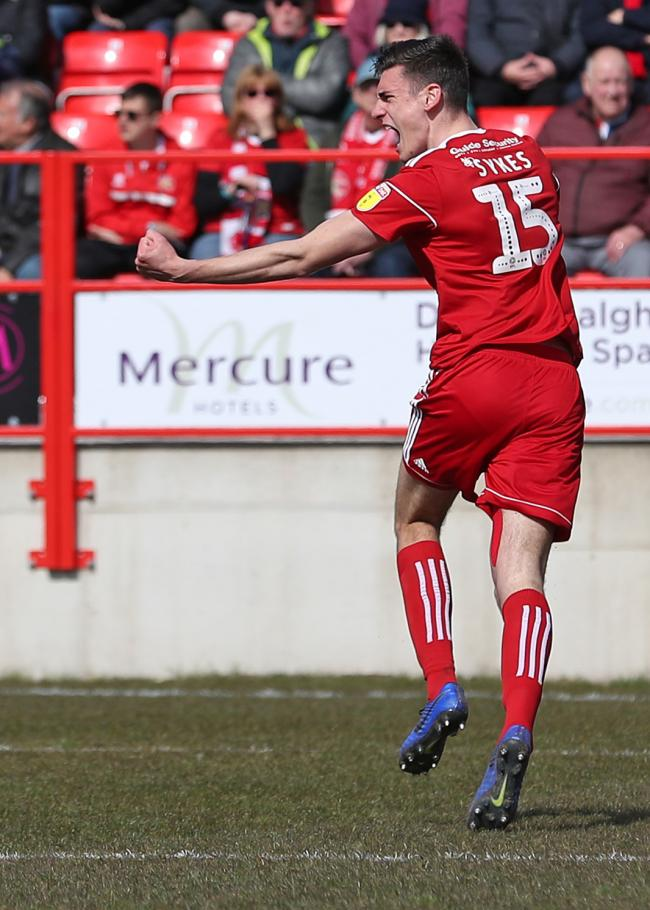 Ross Sykes celebrates opening the scoring against Walsall. Picture: KIPAX
