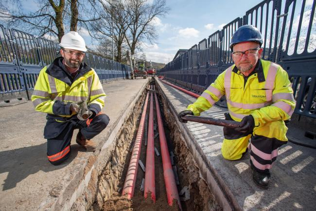 Ben Fiddler, delivery manager for Electricity North West and Stephen Coggin, site manager, along with some of the old cables being replaced
