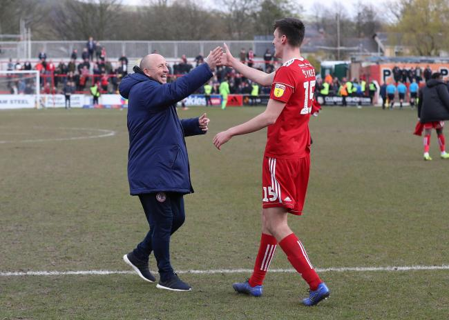 John Coleman with Ross Sykes after Stanley's win over Walsall