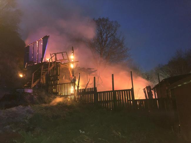 A deliberate fire destroyed the allotment sheds. Picture by Bacup Fire Services