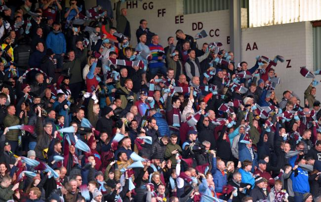 Burnley fans wave scarves in the stands during the Premier League match at Turf Moor, Burnley. PRESS ASSOCIATION Photo. Picture date: Saturday April 13, 2019. See PA story SOCCER Burnley. Photo credit should read: Anthony Devlin/PA Wire. RESTRICTIONS: ED