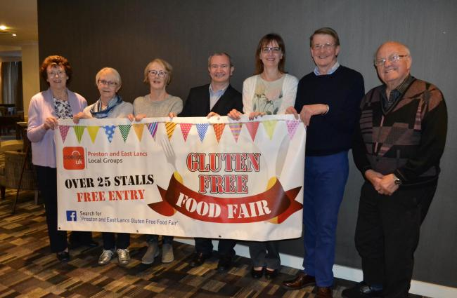 The organisers of a gluten free food fair in the sports hall at Preston's College in Fulwood – left to right are Jean Greenwood, Pat Beesley, Jennifer Doran, Mark Peckham, Vicki Wetton, Stephen Howarth and Michael Greenwood