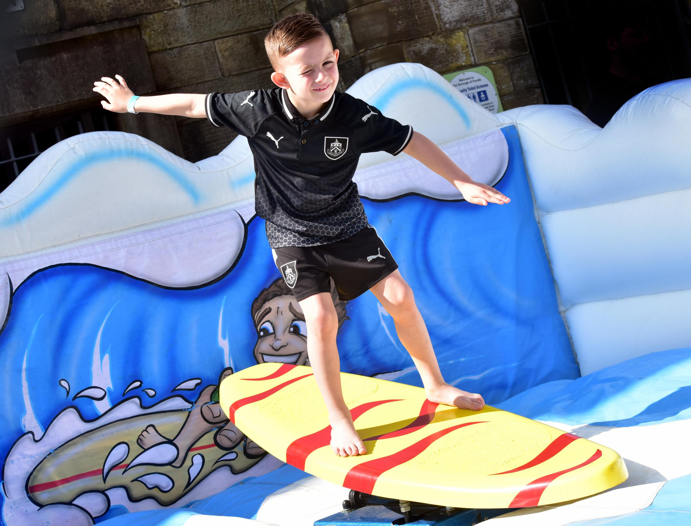Kayden O'Callaghan aged seven attempts a surfing ride at the Nelson Easter extravaganza