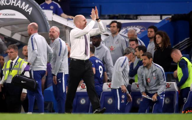Burnley manager Sean Dyche applauds the fans after the Premier League match at Stamford Bridge, London. PRESS ASSOCIATION Photo. Picture date: Monday April 22, 2019. See PA story SOCCER Chelsea. Photo credit should read: Adam Davy/PA Wire. RESTRICTIONS: