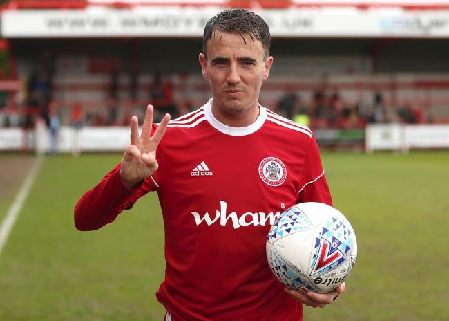Sean McConville celebrates his hat-trick for Stanley against Plymouth