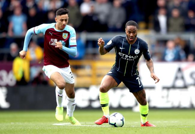 Manchester City's Raheem Sterling (right) and Burnley's Dwight McNeil battle for the ball during the Premier League match at Turf Moor, Burnley. PRESS ASSOCIATION Photo. Picture date: Sunday April 28, 2019. See PA story SOCCER Burnley. Photo cred