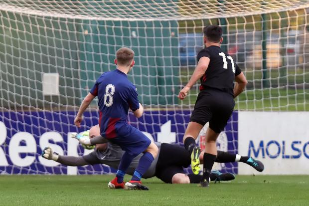Danny Taylor scores Crown Paints third goal against Eleven Sports Media in the LFA Sunday Trophy final