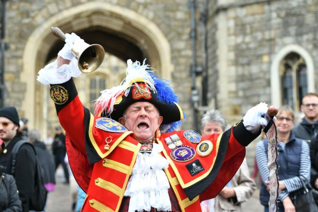 A man dressed as a town crier outside Windsor Castle in Berkshire following the news of the birth of the Duke and Duchess of Sussex's new baby boy
