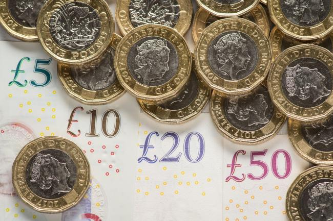 EMBARGOED TO 0001 WEDNESDAY JUNE 26..File photo dated 26/01/18 of money. Parents are cutting back on fresh food, building up debts and being forced to drop children's activities like swimming lessons because of the two-child Universal Credit and tax c