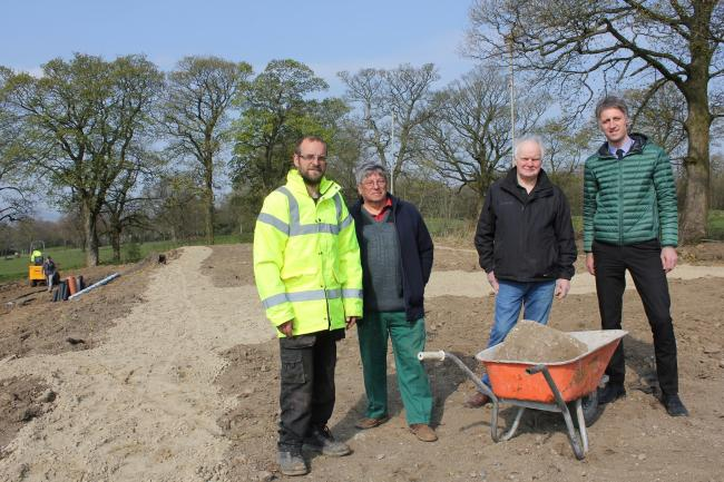 L to R: Matt White, Keith Turbitt of Campion Green Residents, chairman of Colne and Nelson Rugby Club, Chris Buck, and Pendle Council green spaces manager Kieron Roberts