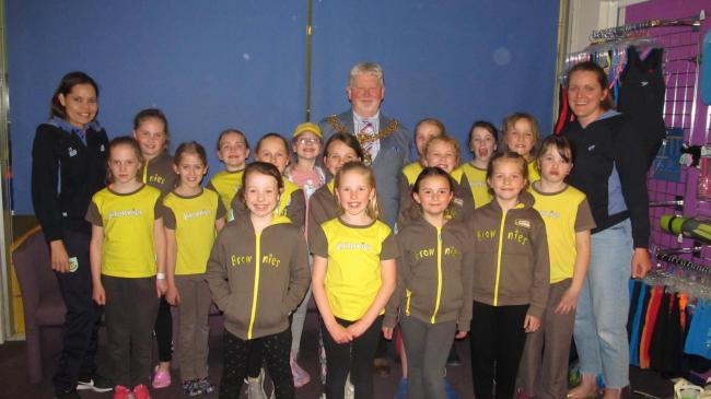 The Brownies and leaders present a cheque to Mayor Cllr James Starkie