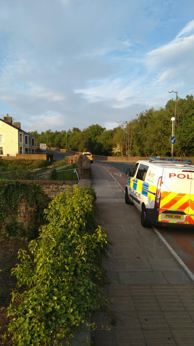 Police near the canal in  in Blackburn Road, Clayton-le-Moors