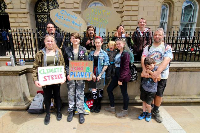 Climate Action Now members raising awareness of global warming outside Blackburn's town hall