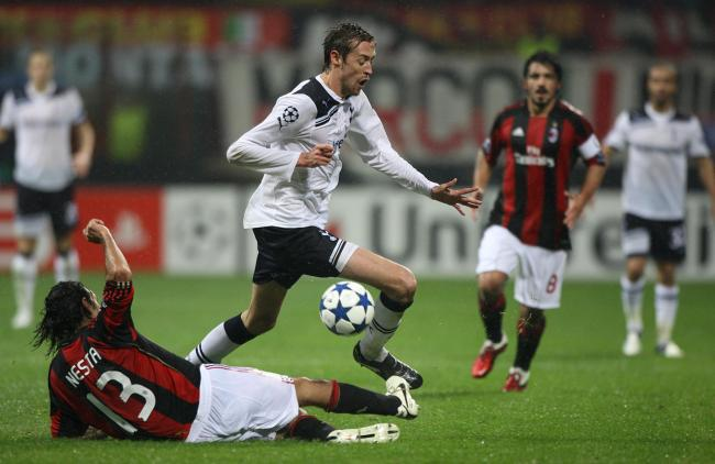 Peter Crouch during his Tottenham days in action against AC Milan in the Champions League